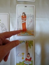 Pointing to Tarot Card in a Reading