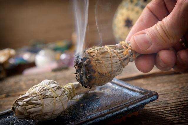 smudging-with-sage-image-source-Monika-Wisniewska/Shutterstock.com